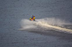 Water motorcycle is rapidly riding on the water surface. Extreme stock photos