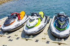 Water motorcycles are parked on the dock. royalty free stock image