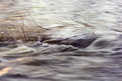 Water of the mountain river shot with long exposure Stock Image
