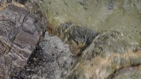 Water in a mountain river in slow motion video. stock video footage