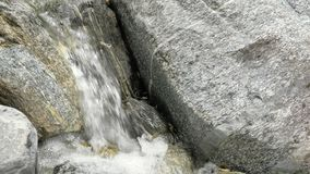 Water in a mountain river in slow motion video. Beautiful water stream in a mountain river in slow motion video. Shooting speed 60fps, slow motion. Live stock video footage