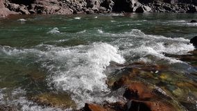 Water mountain river and the wonderful rocky creek royalty free stock photography