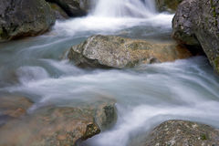 Water on mountain stream Stock Images