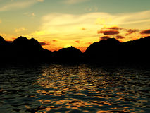 Water Mountains 7. An image of some water with a mountain coastline in the background. With an addition of a setting sun Royalty Free Stock Photos