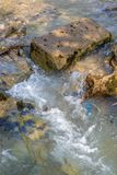 Water in movement. With stones and waves royalty free stock photography