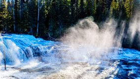Water of the Murtle River as it tumbles over the cusp of Dawson Falls in Wells Gray Provincial Park. In BC, Canada, viewed from the north side royalty free stock images
