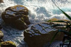Water in natural rock pools on huge rock royalty free stock image