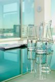 Water and newspaper on table Royalty Free Stock Images