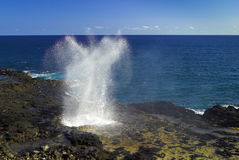 Water from the ocean being sprayed out of the Spouting Horn Royalty Free Stock Images