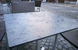 Water on outdoor table Royalty Free Stock Photo