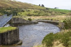The water outfall at the Fofanny Water Treatment Works in the Western Mourne Mountians. With the barren hills on a dull midwinter afternoon Royalty Free Stock Images