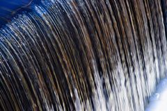 Water Over A Dam. Water pouring over the spillway of a dam Royalty Free Stock Photos