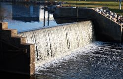 Water over a Dam. Water flowing over a manmade River Dam stock photos
