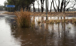 Water over flooded road Royalty Free Stock Photo