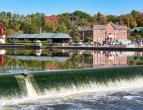 Water Over The Fox River Dam. Crisp fall day along the Fox River in northern Illinois stock image