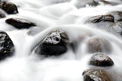Water over rocks Stock Photo