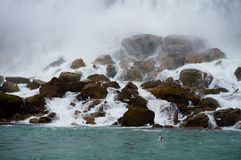 Water over Rocks with Seagulls. Water from Niagara Falls over rocks with seagulls flying near by stock images