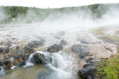 Water Over Rocks. This was a stream that led from a hot spring at Yellowstone National Park. The hot spring steamed behind this area of the stream that ran over Stock Photos