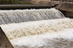Water over rubber dam blocking the river for agriculture Stock Photos