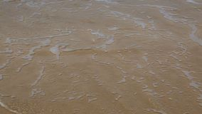 Water over the sand stock footage