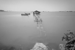 Water overflow on a broken wooden bridge in black and white Royalty Free Stock Photography