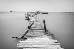 Water overflow on a broken wooden bridge in black and white Royalty Free Stock Photos