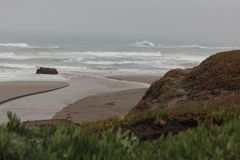 Water overflow reach the Pacific Coastline stock image