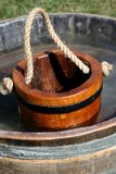 Water Pail in Barrel Stock Image