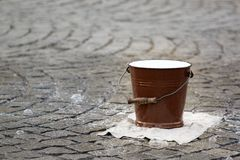 Water pail on the street. Photo shows a closeup of a water pail on the street royalty free stock images