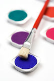Water paints and brush Royalty Free Stock Photo
