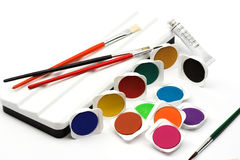 Water paints and brushes royalty free stock image