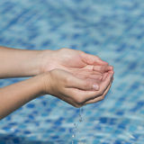 The water in the palms of women.  Royalty Free Stock Images