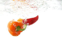 Water and paprika. Small display of fresh vegetable Stock Photo