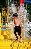 Water Park. Little boy running through waterpark royalty free stock images