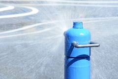 Water Park. Water spraying from a hydrant at a water park Stock Image