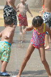 Water park. Kids running around playing at a water park Royalty Free Stock Photo