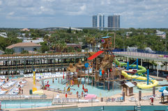 Water park activity. Aerial view of water park filled with bathers and aquatic amusements Royalty Free Stock Photo