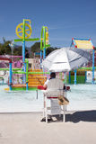Water Park Lifeguard. Water park scene with lifeguard on duty. Sunny skies and warm weather makes for a great day of play time at the water park Stock Photo