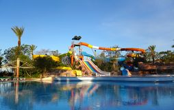 Water park reflection in swimming pool stock photography