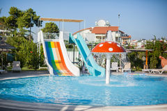 Water park. water-slide. Colorful plastic water-slide in swimming pool. Water park for children stock photography