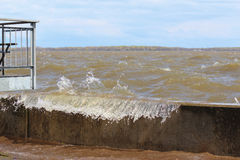 Water passing over the dam at Pointe Calumet marina royalty free stock photo