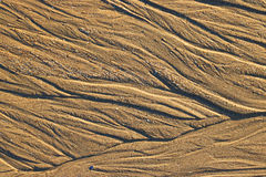 Water patterns in the sand. Background. Royalty Free Stock Photo