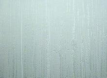 Water patterns on window Stock Photo