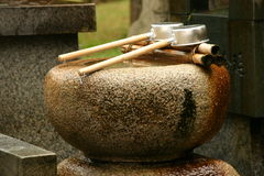 Water and peace. Water for spiritual cleaning in a Japanese temple Royalty Free Stock Photos