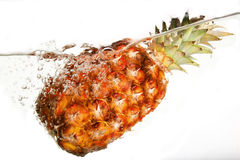 Water and pineapple. Small display of fresh fruit Royalty Free Stock Images