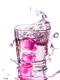 Water with pink ice cubes Royalty Free Stock Photos