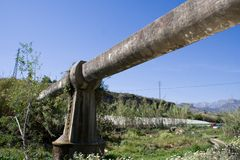 Water Pipe. Large diameter water pipe crosses a valley royalty free stock photo