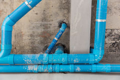 Water,pipe,blue,construction,new,building,job. Blue water pipes in building new construction Stock Photo