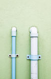Water pipe. Blue plastic  on the wall Royalty Free Stock Photo