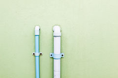 Water pipe. Blue plastic  on the wall Royalty Free Stock Images